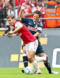 23.07.2011,  Rhein Energie Stadion, Koeln, GER, FSP, 1. FC Koeln vs Arsenal London, im Bild:  Zweikampf zwischen Sascha Riether (Koeln #5) (R) gegen Jack Wilshere (Arsenal #19)...// during the friendly match, 1. FC Koeln vs Arsenal London on 2011/07/23, Rhein-Energie Stadion, Köln, Germany. EXPA Pictures © 2011, PhotoCredit: EXPA/ nph/  Mueller *** Local Caption ***       ****** out of GER / CRO  / BEL ******