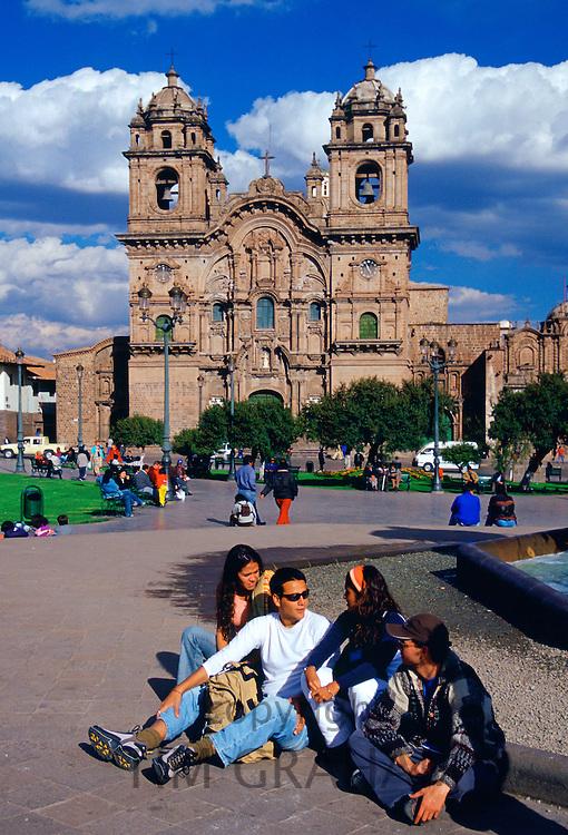 Young people gather in front of La Compania Church, Plaza de Armas  square in Cuzco, the ancient capital of the Inca Empire, Peru, South America