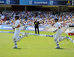 © Licensed to London News Pictures. 18/07/2013. England's Nick Cook (L) and Joe Root come out to open the innings on day one of  Second Test England v Australia The Ashes Lord's Cricket Ground, London 18/07/2013<br /> . Photo credit: Mike King/LNP