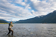 David Page works the tide, and evening light, to find fresh chinook coming into the Dean River boca.