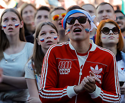 June 25, 2018 - Saint Petersburg, Russia - Russia supporters react during the FIFA World Cup 2018 match between Russia and Uruguay on June 25, 2018 at Fan Fest zone in Saint Petersburg, Russia. (Credit Image: © Mike Kireev/NurPhoto via ZUMA Press)