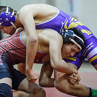 Shiprock Chieftain Jared Pollard grapples with Kirtland Central Bronco Zelldan Clark during the Four Corners Invite at Shiprock High School Wednesday.