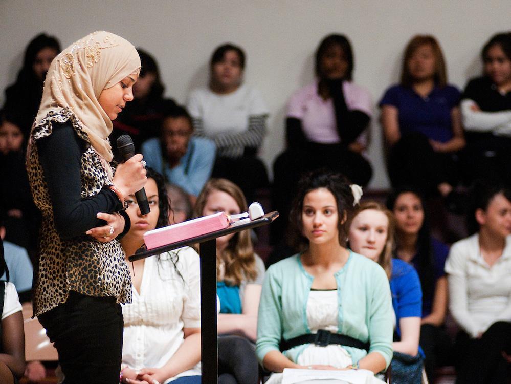 Asrar Musaitif a senior, gives a reading at a graduation mass at St. Joan Antida High School, Tuesday, May 18, 2010.