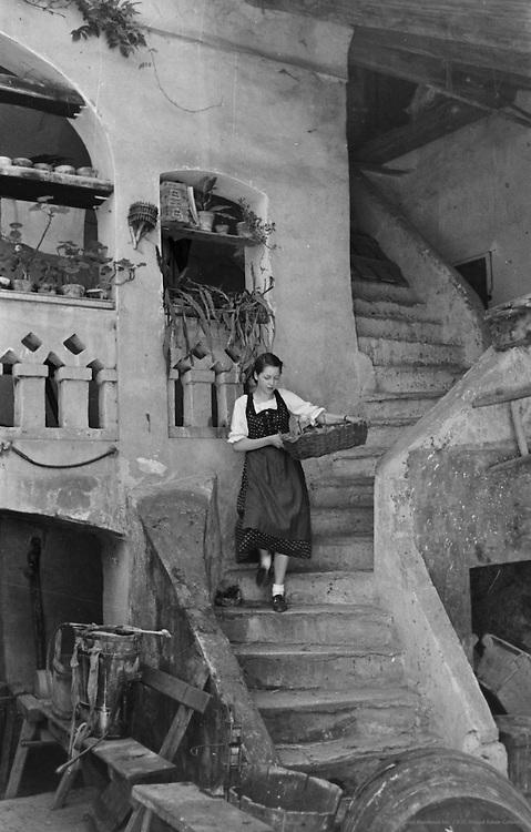 Women descending an old staircase, Spitz, Austria, 1937