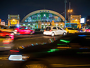 25 OCTOBER 2014 - BANGKOK, THAILAND: Night view of the front of Hua Lamphong Train Station in Bangkok.  Bangkok Railway Station unofficially known as Hua Lamphong Station, is the main railway station in Bangkok, Thailand. It is in the center of the city in the Pathum Wan District, and is operated by the State Railway of Thailand. The station was opened on June 25, 1916 after six years' construction. The site of the railway station was previously occupied by the national railway's maintenance centre, which moved to Makkasan in June 1910. At the nearby site of the previous railway station a pillar commemorates the inauguration of the Thai railway network in 1897. The station was built in an Italian Neo-Renaissance-style, with decorated wooden roofs and stained glass windows. There are 14 platforms, 26 ticket booths, and two electric display boards. Hua Lamphong serves over 130 trains and approximately 60,000 passengers each day. Since 2004 the station has been connected by an underground passage to the MRT (Metropolitan Rapid Transit) subway system's Hua Lamphang Station.    PHOTO BY JACK KURTZ