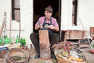 Stevce Donevski, local Slow Food ambassador, preparing sol in front of the Donevski family's guesthouse in Kratovo, Macedonia. Sol is a traditional speciality of Kratovo, made with dried herbs and spices pounded together and served as an accompaniment with bread or other food. © Rudolf Abraham