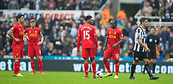 19.10.2013, St. James Park, New Castle, ENG, Premier League, ENG, Premier League, Newcastle United vs FC Liverpool, 8. Runde, im Bild Liverpool's Luis Suarez and Daniel Sturridge look on, disgust as Newcastle United's Hatem Ben Arfa kicks the ball away from the centre spot twice after his side's second goal the Premiership match at St James' Park // during the English Premier League 8th round match between Newcastle United and Liverpool FC St. James Park in New Castle, Great Britain on 2013/10/19. EXPA Pictures © 2013, PhotoCredit: EXPA/ Propagandaphoto/ David Rawcliffe<br /> <br /> *****ATTENTION - OUT of ENG, GBR*****