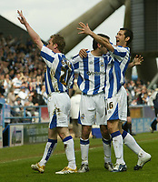 Photo: Aidan Ellis.<br /> Huddersfield Town v Yeovil Town. Coca Cola League 1. 29/04/2006.<br /> Huddersfield's David Graham celebrates his goal and the first of the game with Martin Mcintosh