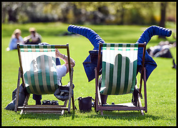 April 17, 2018 - London, England, United Kingdom - A couple sit on deckchairs as people flock to London's St James's Park to take advantage of sunny spell in the Capital. (Credit Image: © Pete Maclaine/i-Images via ZUMA Press)