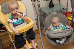 Twin boys at home in baby chairs. (This photo has extra clearance covering Homelessness, Mental Health Issues, Bullying, Education and Exclusion, as well as the usual clearance for Fostering & Adoption and general Social Services contexts,)