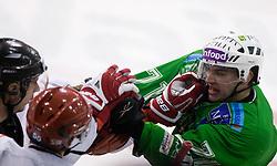 Bostjan Golicic of Tilia Olimpija in fight with Rok Ticar of Acroni at 38th Round of EBEL league  ice hockey match between HDD Tilia Olimpija Ljubljana and HK Acroni Jesenice, on January 1, 2010, in Arena Tivoli, Ljubljana, Slovenia. (Photo by Vid Ponikvar / Sportida)