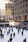Winter scene of New Yorkers, keen skaters, ice skating at ice rink at the Rockefeller Center in New York, USA