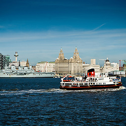 Its a classic shot.  Beautiful day.  The Mersey looks clean and blue. Theres a ferry, a naval vessel, the 3 Graces.  Its just a lovely day.