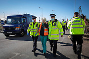 Police start to arrest and detain activists from Insulate Britain who have blockaded the entrance to the port of Dover on the 24th of September 2021 in Dover, United Kingdom. Over 40 activists from Insulate Britain blocked the road with some gluing themselves to the carriageway of the A20 at the Eastern docks roundabout. There are blocking the roads to highlight that fuel poverty is killing people in Dover and across the UK.