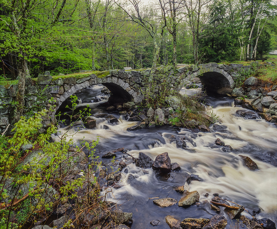 Double stone arch bridge over North Branch River in spring, Stoddard, NH