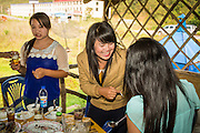 14 MARCH 2013 - BOTEN, LAOS:  Women tell jokes and drink in a karaoke bar in Boten Special Economic Zone in Boten, Laos.  PHOTO BY JACK KURTZ