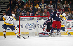 November 7, 2017 - Columbus, OH, USA - The Nashville Predators' Calle Jarnkrok (19) scores the game-winning goal against Columbus Blue Jackets goalie Joonas Korpisalo (70) during the third period at Nationwide Arena in Columbus, Ohio, on Tuesday, Nov. 7, 2017. The Predators won, 3-1. (Credit Image: © Kyle Robertson/TNS via ZUMA Wire)