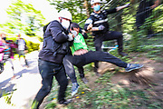 Bailiffs forcibly remove an environmental activist from the HS2 at the Harvil Road site at the start of eviction on Tuesday, May 12, 2020. Police were rarely seen at the site and bailiffs by the Dews Lane in the Colne Valley, in the London borough of Hillingdon often used various soft forms of violence to enforce eviction, which protesters claim that HS2 and the bailiffs are acting unlawfully as they have not served the demonstrators with high court eviction notices ordering them to vacate the land. (Photo/ Vudi Xhymshiti)