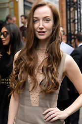 © Licensed to London News Pictures. 17/09/2016. OLIVIA WILDE arrives for the JULIEN MACDONALD Spring/Summer 2017 show. Models, buyers, celebrities and the stylish descend upon London Fashion Week for the Spring/Summer 2017 clothes collection shows. London, UK. Photo credit: Ray Tang/LNP