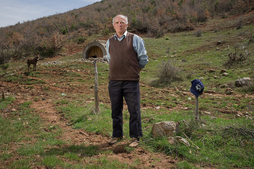 Jovan Malevski (71) in his field near the village of Glloboçeni, Albania
