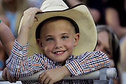 Braydon Coy, 5, of Gladewater is ready to enjoy some rodeo cowboy bronc riding at the 72nd Gladewater Rodeo on Wednesday. Photo: Jaime R. Carrero/Tyler Mornng Telegraph