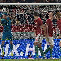 Denes Dibusz (L) of Hungary saves a goal during the inauguration match of the newly reconstructed Ferenc Puskas Stadium between Hungary and Uruguay in Budapest, Hungary on Nov. 15, 2019. ATTILA VOLGYI