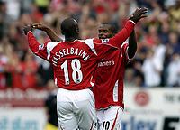 Photo: Olly Greenwood.<br />Charlton Athletic v Arsenal. The Barclays Premiership. 30/09/2006. Charlton's Darren Bent celebrates scoring with Jimmy Floyd Hasselbaink.