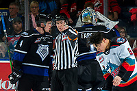 KELOWNA, BC - JANUARY 3:  Referee Trevor Nolan sends Will Warm #4 of the Victoria Royals to the bench after a squirmish with Trevor Wong #8 of the Kelowna Rockets at Prospera Place on January 3, 2020 in Kelowna, Canada. (Photo by Marissa Baecker/Shoot the Breeze)