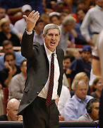 March 12, 2003, Orlando, Florida, USA;  Head coach Jerry Sloan of the Utah Jazz gives Official Ron Olesiak some advice on making a call as the Jazz defeat the Orlando Magic 111-108.