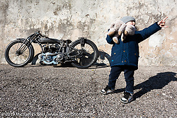 A little boy with his Teddy Bear passes by Abnormal Cycles custom bike builder Samuele Reali's 1919Swiss MAG Motosacoche with its automatic adjustable Brough Superioroiler,Sturmey and Archer transmission and aCorbin Duplex rear wheel hub from a 1916 Indian.Photographed at Motor Bike Expo, Verona, Italy. Sunday, January 21, 2018. Photography ©2018 Michael Lichter.