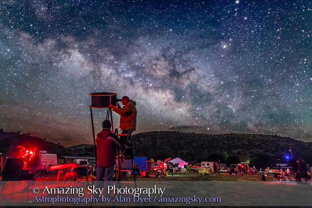 Observers at the Texas Star Party explore the wonders of the deep sky under the rising Milky Way, in May 2015. Sagittarius and Scorpius are in the background, with the centre of the Galaxy rising in the southeast. This is a single 30-second exposure at f/2 with the 24mm lens and Canon 5D MkII at ISO 4000.
