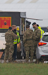 © Licensed to London News Pictures 23/12/2020.        Manston, UK. The Army at the airport. The Army and NHS staff have arrived at Manston Airport to administer Covid-19 lateral flow tests to truckers who are stranded in Kent. Angry lorry drivers blockading local roads and clashed with police in Kent this morning. France have closed its borders to all freight traffic because of the new Coronavirus strain. Photo credit:Grant Falvey/LNP
