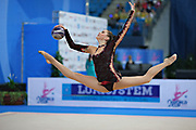 Alina Maksimenko during qualifying at ball in the Pesaro World Cup at the Adriatic Arena in Pesaro, Italy on 26 April 2013.<br /> Alina is an Ukrainian individual rhythmic gymnast. She was born on July 10, 1991 in Zaporizhia, Ukraine.