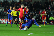 Gareth Bale of Wales is fouled by Croatia's Vedran Corluka.  FIFA World cup 2014 qualifier, group A , Wales v Croatia at the Liberty Stadium in Swansea, South Wales on Tuesday 26th March 2013. pic by Andrew Orchard, Andrew Orchard sports photography,