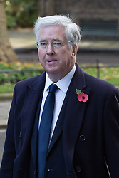 © Licensed to London News Pictures. 13/11/2016. LONDON, UK.  Defence Secretary, MICHAEL FALLON walking through Downing Street to the annual Remembrance Sunday service at the Cenotaph memorial in Whitehall, which is held in tribute for members of the armed forces who have died in major wars and conflicts. Photo credit: Vickie Flores/LNP