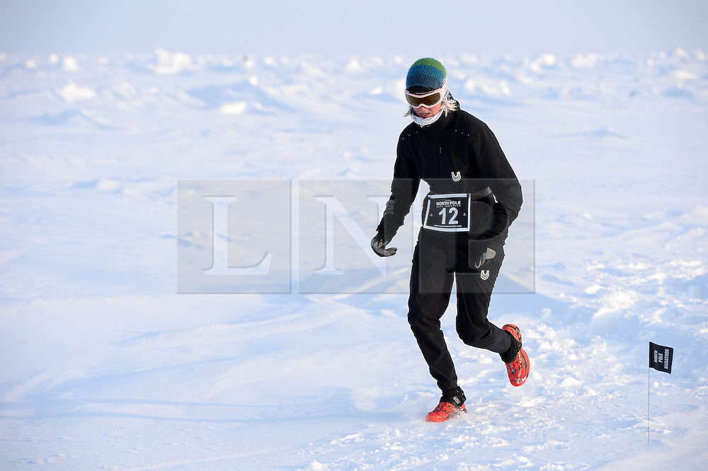 © Licensed to London News Pictures. 10/04/2014. The UVU North Poe marathon 2014 which took place at a temperature of minus 30 degrees. Run over the classic 42.195km (26.2 miles ) marathon distance it is described as the world coldest marathon. Held at the top of the world it is also the worlds most remote marathon race. The men's race was won by Michael Wardian of USA (not pictured) with a time of 4:07:40 hrs. Photo credit : Mike King/LNP
