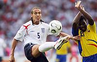 Photo: Chris Ratcliffe.<br /> England v Ecuador. 2nd Round, FIFA World Cup 2006. 25/06/2006.<br /> Rio Ferdinand of England clashes with Carlos Tenorio of Ecuador.
