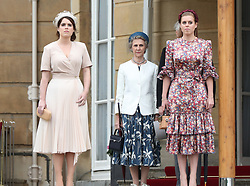 Princess Eugenie and Princess Beatrice arrive for a Royal Garden Party at Buckingham Palace in London.