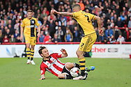 Brentford midfielder, Sam Saunders (7) tackling Fulham defender, Ashley (Jazz) Richards (02) during the Sky Bet Championship match between Brentford and Fulham at Griffin Park, London, England on 30 April 2016. Photo by Matthew Redman.