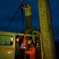 Members of a Smithsonian Museum archaeology team monitor nightime laser scanning of bronze-age Deer Stones at Ulaan Tolgoi site near Muren, Mongolia.