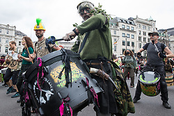London, UK. 23rd August, 2021. Samba drummers from Extinction Rebellion take part in the first day of Impossible Rebellion protests. Extinction Rebellion are calling on the UK government to cease all new fossil fuel investment with immediate effect. Credit: Mark Kerrison/Alamy Live News