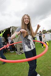 Girl enjoying hula hooping at a Parklife summer activities event,