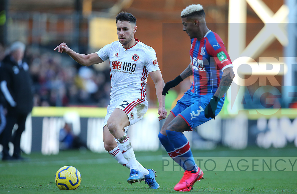 Sheffield United's George Baldock and Crystal Palace's Patrick van Aanholt challenge for the ball during the Premier League match at Selhurst Park, London. Picture date: 1st February 2020. Picture credit should read: Paul Terry/Sportimage