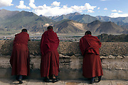 Buddhist pilgrims visit Drepung Monastery outside Lhasa.On auspicious dates sacred shrines are opened. The monastery is home to less than 1/10th of its population of monks before the Chinese invasion.