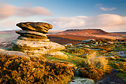 Higger Tor's plateau, as seen from the rock formations at Over Owler Tor in the Peak District. A sunrise landscape scene in England, UK.