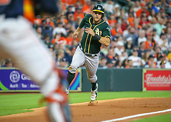 April 29, 2018 - Houston, TX, U.S. - HOUSTON, TX - APRIL 29:  Oakland Athletics center fielder Chad Pinder (18) runs toward home plate and scores a run in the top of the third inning during the baseball game between the Oakland Athletics and Houston Astros on April 29, 2018 at Minute Maid Park in Houston, Texas.  (Photo by Leslie Plaza Johnson/Icon Sportswire) (Credit Image: © Leslie Plaza Johnson/Icon SMI via ZUMA Press)