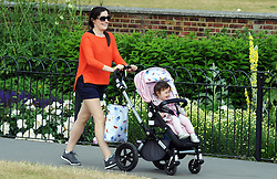 © Licensed to London News Pictures. 18/06/2015<br /> A mother and baby enjoying a walk in Greenwich Park,Greenwich,London.<br /> Greenwich Sunny weather in South East London,UK.<br /> Early morning sunny weather in Greenwich Village and Greenwich Park today (18,06,2015)<br /> (Byline:Grant Falvey/LNP)