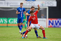 RHYL, WALES - Monday, September 4, 2017: Wales' Keiran Evans and Iceland's Guðmundur Andri Tryggvason during an Under-19 international friendly match between Wales and Iceland at Belle Vue. (Pic by Paul Greenwood/Propaganda)