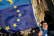 Anti Brexit pro remain demonstrators protest waving European Union flags in Westminster opposite Parliament on the day that Conservative Party MPs triggered a vote of no confidence in the Prime Minister on 12th December 2018 in London, England, United Kingdom.