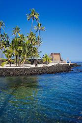 Keone`ele Cove, reconstructed old Hawaiian temple, Hale o Keawe Heiau, the Great Wall bult in the mid-1500s, Coconut Palms, Cocos nucifera, in background, Pu`uhonua o Honaunau or Place of Refuge National Historical Park, Honaunau, Big Island, Hawaii